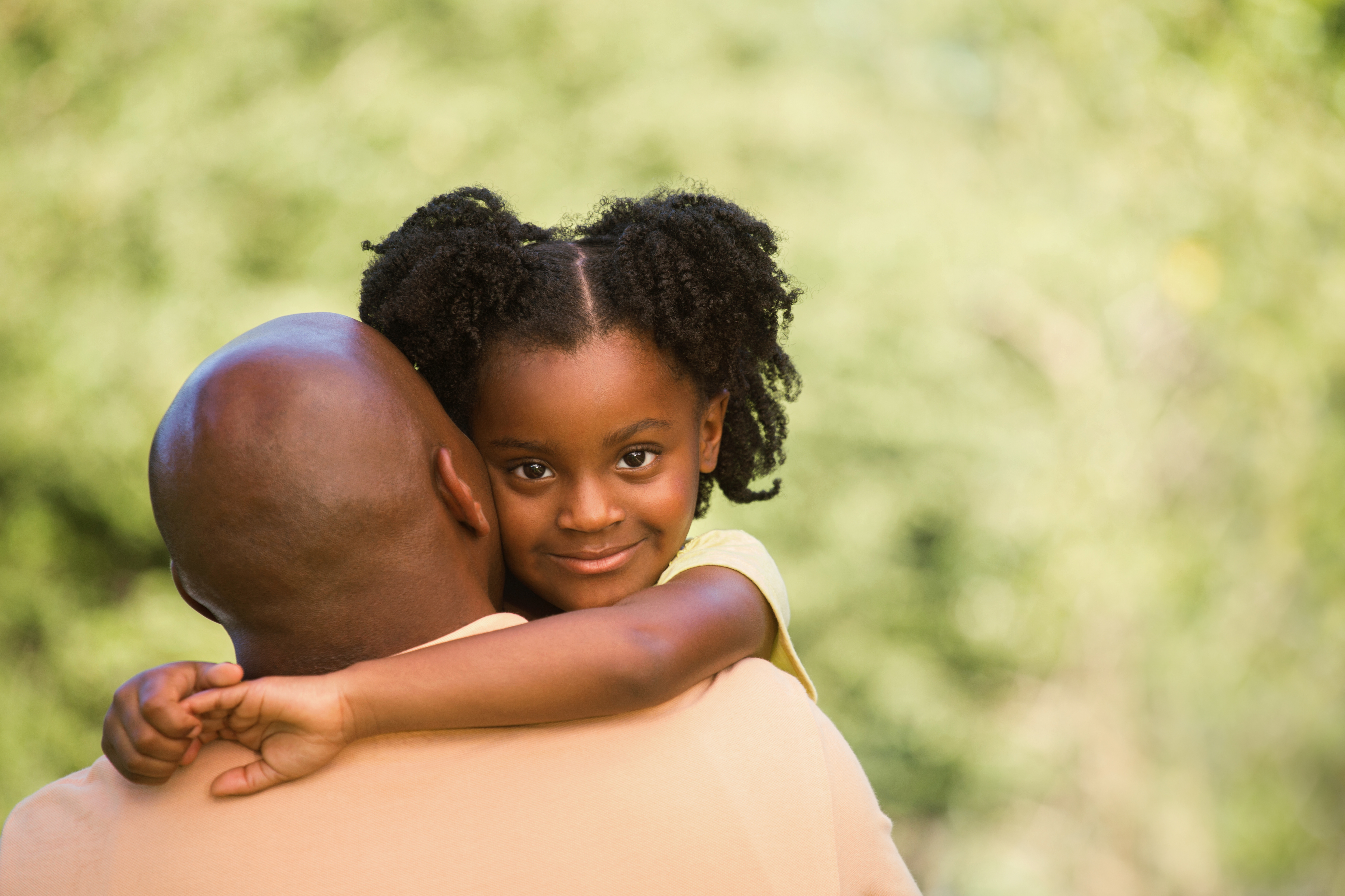 African American Father holding his daughter