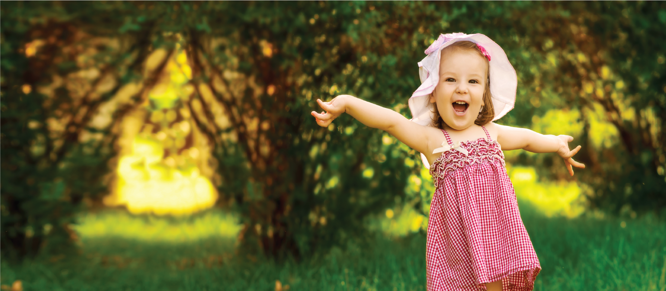 Outdoor portrait of a cute young white little girl smiling - white people